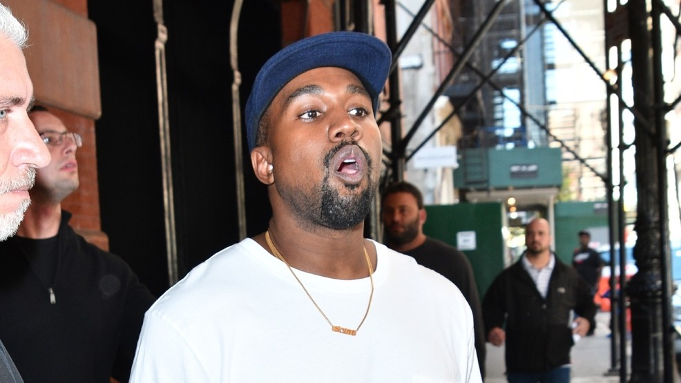 57064430bb6a4 Kanye West gives  100 and Yeezy sneakers to homeless man