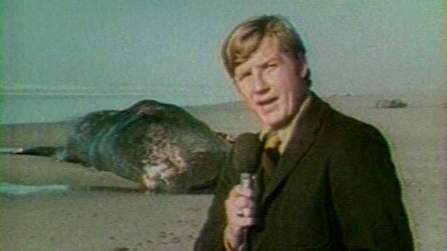 """Reporter Paul Linnman and photographer Doug Brazil visited the Oregon Coast on November 12, 1970. """"It had to be said the Oregon State Highway Department not only had a whale of a problem on its hands,"""" Linnman reported. """"It had a stinking whale of a problem."""""""